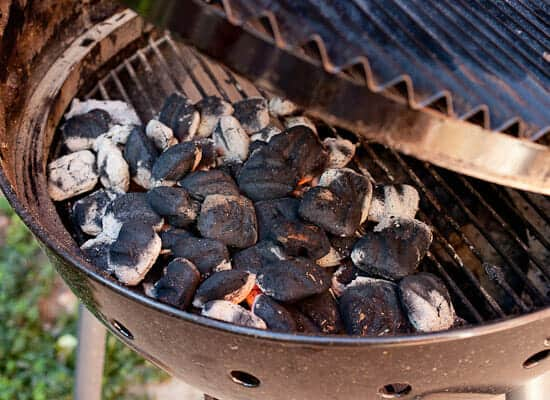 Preparing grill for chicken wings.