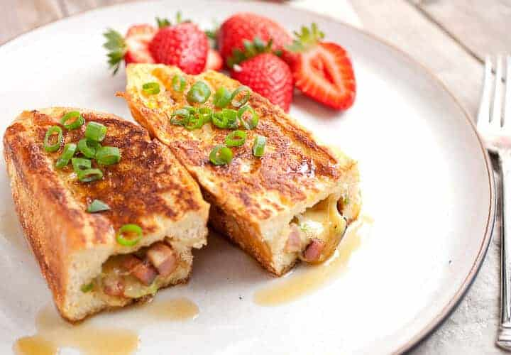 Savory Stuffed French Toast! This is the French toast of your dreams. The perfect mix of savory and sweet smashed together in thick pieces of French bread. So delicious and trust me when I say it's easier than it looks to make! | macheesmo.com