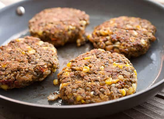 Spicy lentil burgers cooking