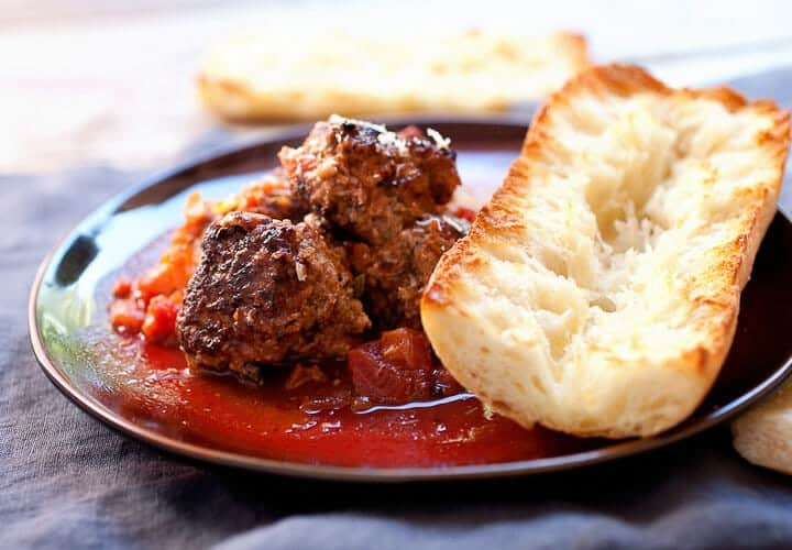 Easy Braised Meatballs: These delicious homemade braised meatballs are slow-simmered in tomatoes and red wine and so good served over pasta or with a crusty piece of bread. You could even make a sandwich out of them! | macheesmo.com