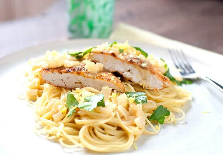 Weeknight Crispy Chicken: This super-simple, under 30 minute dish is perfect for a weeknight. Crispy chicken cutlets with lemon, a simple cream sauce, and angel hair pasta! | macheesmo.com