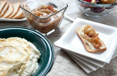 Roasted Grapes with Whipped Goat Cheese: This is such an EASY and decadent appetizer. It's almost cheating how amazing it is. Tangy goat cheese, whipped until light and fluffy, and served with slightly sweet and bursting roasted grapes. Put them out at every party you have this winter. | Macheesmo.com