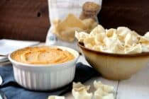 Spicy Cauliflower Dip: This healthy dip is a great substitution for a classic baked cheese dip. It has just enough sharp cheddar and is loaded with pureed cauliflower and delicious spices. I like to serve mine with Simply7 Lentil chips! #sponsored | macheesmo.com
