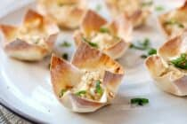 Hot Crab Dip Wonton Cups: These are the most addictive little bites you'll find on an appetizer table. Hot crab dip spiced with Old Bay seasoning, shallot, and just a dash of hot sauce. Baked right into a crispy wonton cup! | macheesmo.com