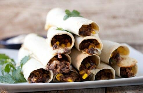 """Simple Bean and Cheese Flautas: These Tex-Mex """"flutes"""" are filled with pepper jack cheese and a quick black bean and corn mash. A plate of them makes for great appetizers or stack up a few and make a quick meal out of them! 