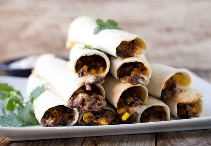 "Simple Bean and Cheese Flautas: These Tex-Mex ""flutes"" are filled with pepper jack cheese and a quick black bean and corn mash. A plate of them makes for great appetizers or stack up a few and make a quick meal out of them! 