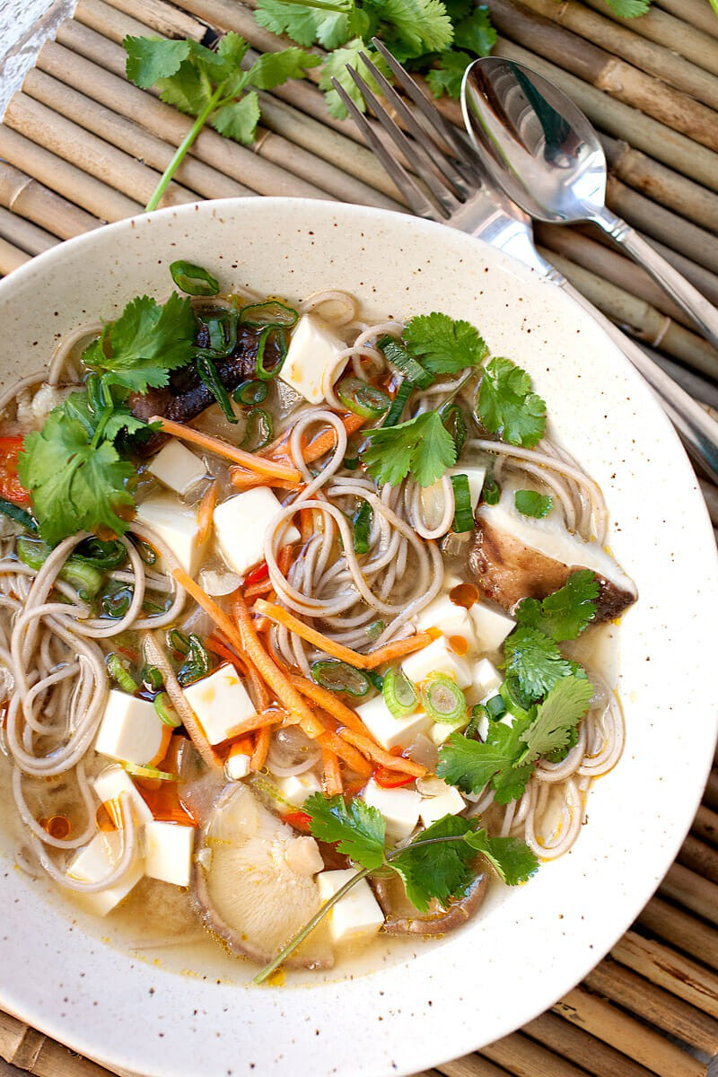 Simple Miso Soba Soup: This is the soup you need to cure the winter sniffles! Loaded with savory umami miso broth, mushrooms, soba, and light tofu, the soup is warming and has just enough spice to wake up the tastebuds. Plus, it only takes about 30-40 minutes to get it on the table! | macheesmo.com