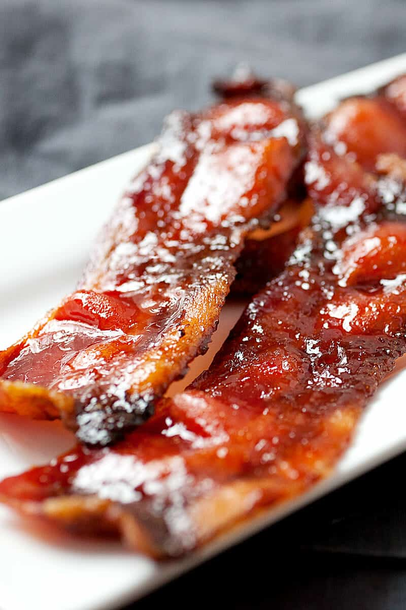 Sriracha Candied Bacon: This is a super-simple twist on bacon that will hit all the right tastebuds. Slightly sweet and spicy, this is bacon at its best! | macheesmo.com