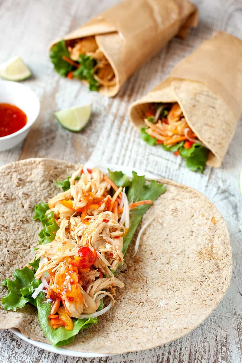 Sweet Chili Chicken Wraps: Shredded chicken simmered in a simple sweet chili lime sauce and stuffed inside flatbread wraps with fresh, crunchy veggies. The perfect quick wrap for dinner!