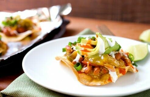 Chunky Tomatillo Tostadas: These crispy tostadas are topped with roasted tomatillos, pinto beans, queso fresco, and lots of other good toppings. Quick vegetarian Tex-mex dinner alert! | macheesmo.com