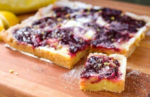 Lemon Cherry Swirl Bars: These simple baked dessert bars are gluten-free and use Bob's Red Mill Almond Flour for the crust! The bars are bright, fruity, tangy, and so very addictive. The recipe uses real lemons and cherries! #spons | macheesmo.com