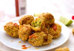 Guacamole Tots: Fried little bites of guacamole, queso fresco, and crumbled corn chips make for maybe the best Tex-Mex appetizer out there. Totally worth the work and very addictive! Warm guacamole is a very real thing! | macheesmo.com