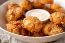 Bited Sized Blooming Onions: The perfect bite-sized version of the popular fried onion appetizer! Easy to share and easy to eat! So delicious and crispy with a soft slightly sweet and tangy bite. So good! | macheesmo.com