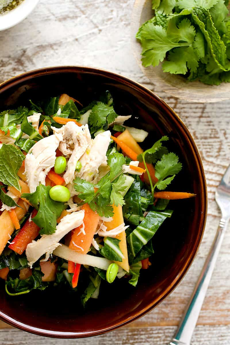 Easy Thai Chicken Salad: Poached chicken and chopped bok choy tossed with crunchy veggies and ripe papaya fruit. Tossed with lots of fresh herbs and a sweet/savory fish sauce dressing. Perfect for a light dinner or packed lunches! | macheesmo.com