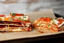 Pepperoni Pizza Stack: The key to this beautiful and delicious creature is to use thin crusts so the finished stack isn't too dough-filled! Layers of cheese, pepperoni, peppers, and onions makes for one delicious stack. I like to use Flatout Flatbread Artisan Thin Crust Pizza Crusts for my layers! #sponsored | macheesmo.com