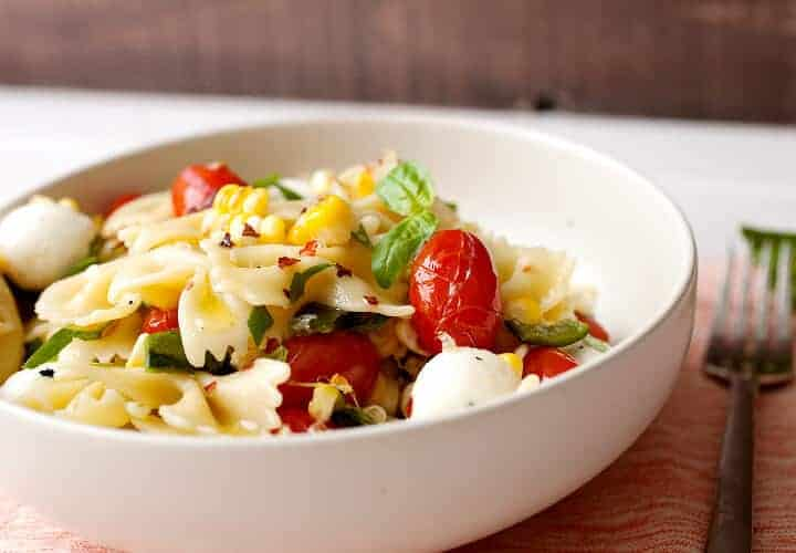 Grilled Tomato and Corn Pasta Salad: A perfect summer pasta salad with blistered grape tomatoes, charred sweet corn, and fresh mozzarella balls. Make it as a light summer dinner, weekday lunches, or it's perfect for an afternoon picnic! | macheesmo.com