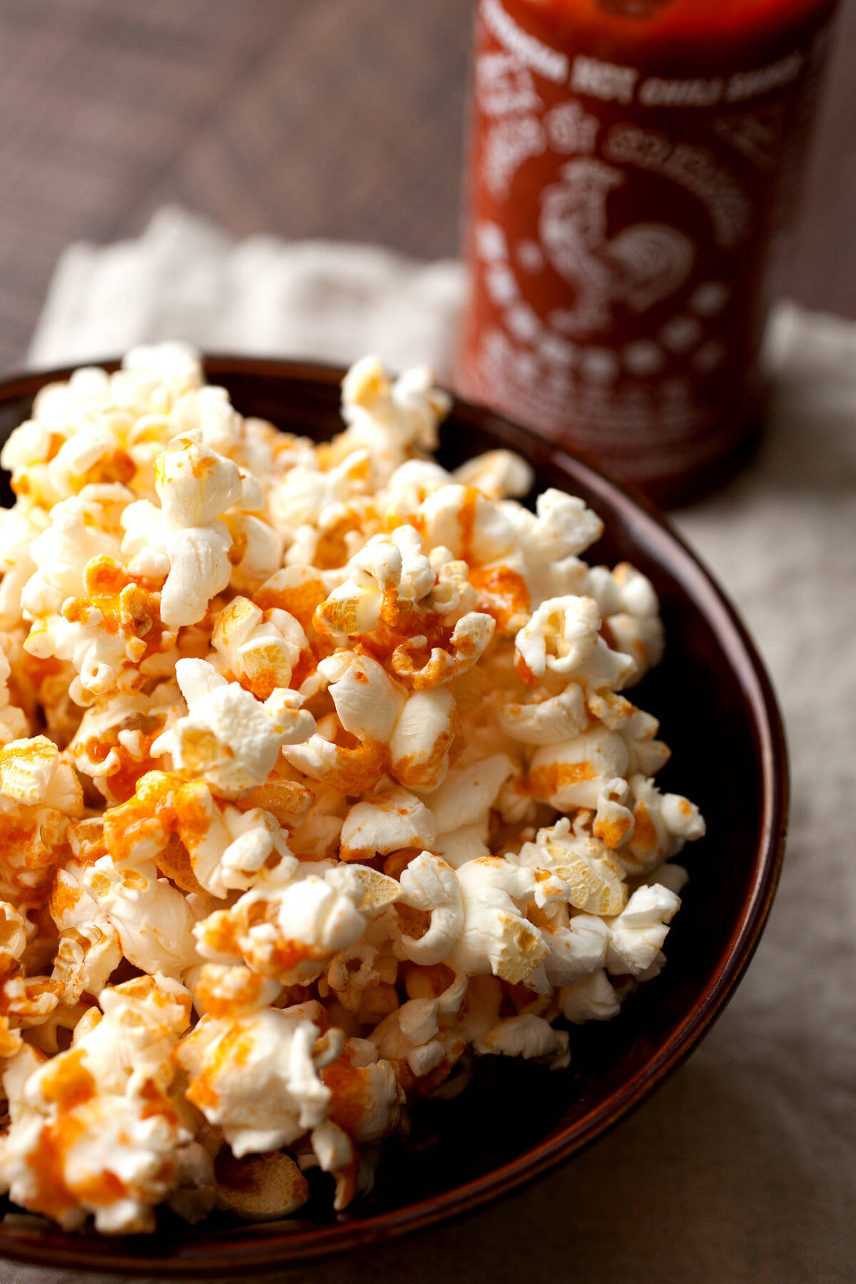 Brown Butter Sriracha Popcorn: Possibly the most addictive popcorn I've ever had. Slightly sweet with a hint of brown butter and just enough spice. Gotta love good popcorn! | macheesmo.com