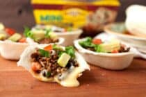 Molten Taco Boats: Mini taco boats with a hidden layer of homemade queso. Topped with any taco fillings you like. Such a fun appetizer! | macheesmo.com