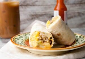 Make Ahead Breakfast Burritos: These are a great weekday breakfast idea. Be sure to check out my easy trick for making your burrito taste as fresh and delicious as possible! | macheesmo.com