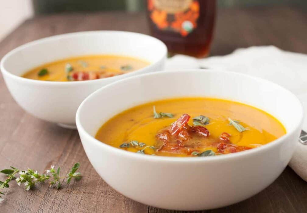 Butternut Squash Soup with Maple Bacon: Say hello to fall with this delicious roasted squash soup. The soup itself is really easy but gets a nice crunch and sweetness from crumbled maple bacon on top! YUM!   macheesmo.com