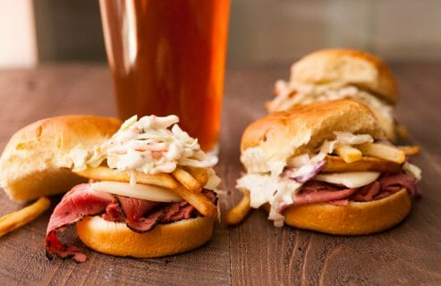 Primanti Style Sliders: Perfect game day snacks on mini slider buns. Made in the style of the classic Pittsburgh Primanti Bros sandwiches with crispy french fries IN the sandwich! So good! | macheesmo.com
