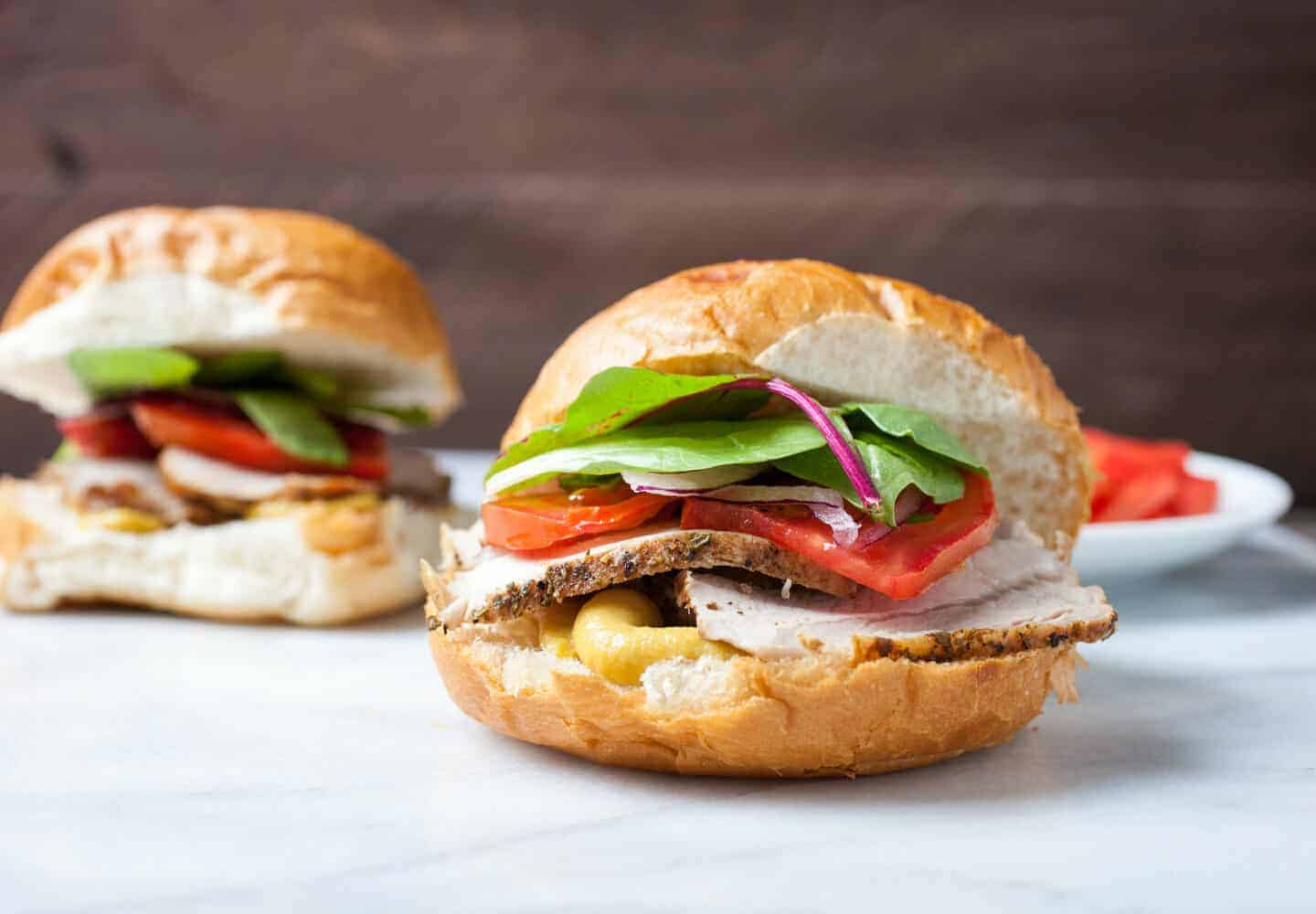 Balsamic Roasted Pork Sandwiches: Slow roasted pork glazed with a simple balsamic sauce, sliced thin, and served with honey mustard sauce and fresh veggies. Such a great sandwich! | macheesmo.com