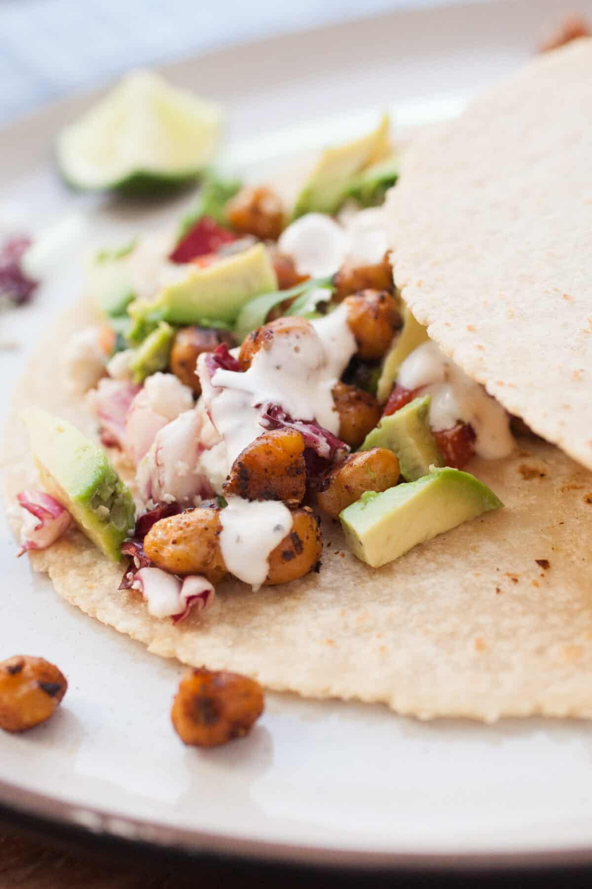 Crispy Chickpea Tacos: These fast and delicious vegetarian tacos are plenty filling and have great toppings: a quick slaw and a creamy avocado sauce. YUM! | macheesmo.com