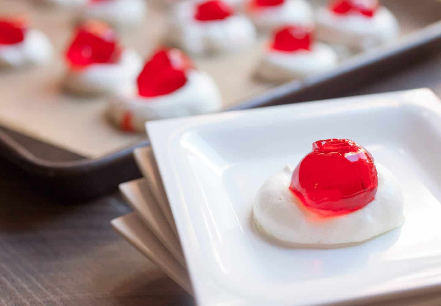 Meringue Jelly Shots: Fun orbs of jelly (with some optional booze) nestled in a completely edible meringue cup. Really fun and a perfect party treat! | macheesmo.com