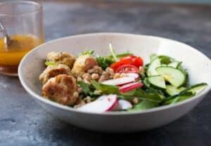Apple Cider Farro Chicken Bowls: Slow simmered farro in apple cider makes for a perfect base for a winter bowl. I like to top mine with mini chicken meatballs and fresh veggies! | macheesmo.com
