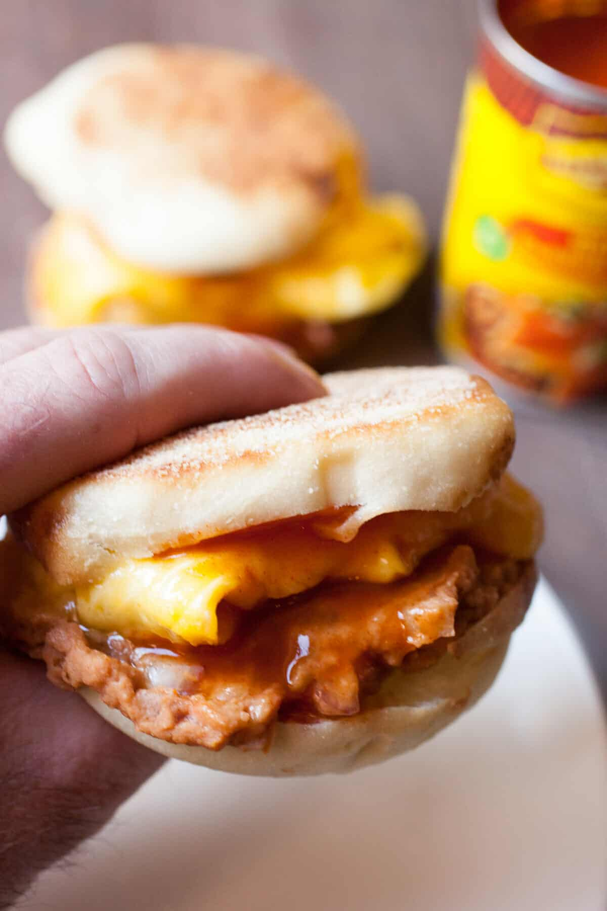 Enchilada Breakfast Sandwiches: A quick and easy breakfast sandwich with delicious Tex-Mex flavors. Don't skip breakfast! | macheesmo.com