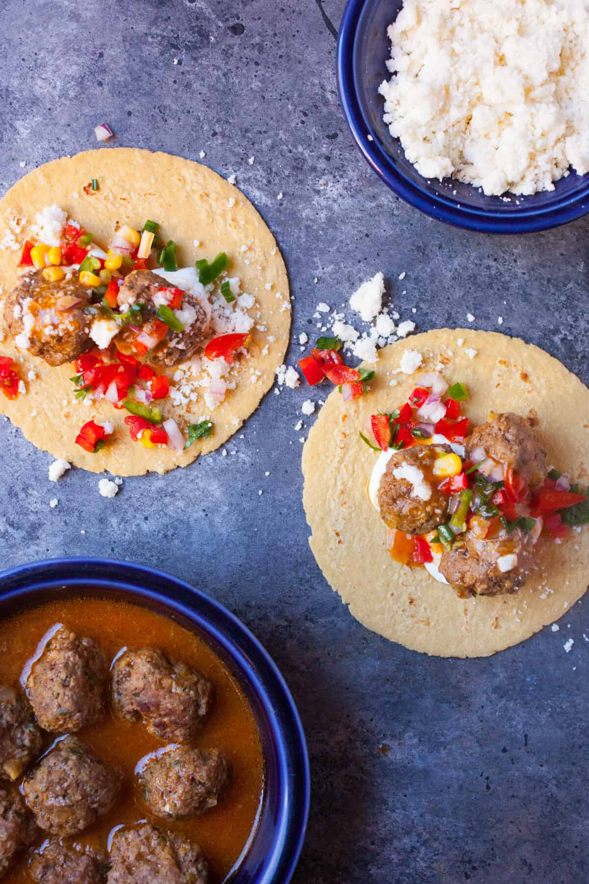 Enchilada Meatball Tacos: These simmered meatballs are packed with flavor and great served as tacos or individually as appetizers. They also freeze perfectly! | macheesmo.com