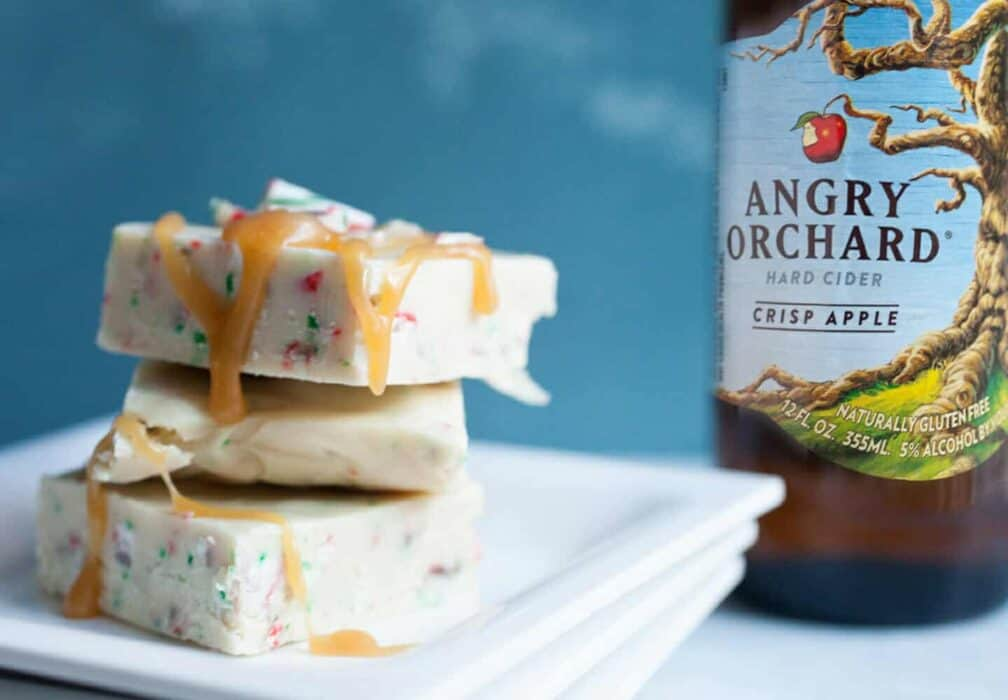 Hard Cider White Peppermint Fudge: This easy holiday fudge starts with reduced Angry Orchard Hard Cider. Plus, I like to top mine with a drizzle of Fireball Whisky caramel! YUM. | macheesmo.com