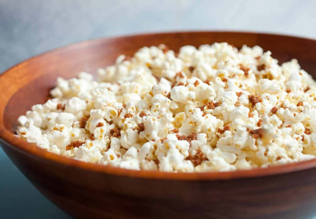 Bacon Dust Popcorn: A bacon lover's dream. This popcorn is coated with big spoonfuls of what I call bacon dust. Dried and ground bacon bits with salt and sugar mixed in. It's a perfect snack topper. Enjoy!   macheesmo.com