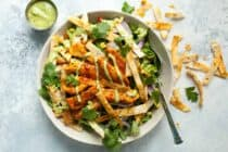 Chicken Tortilla Salad: This is a about as flavorful as a salad can get! Perfectly seasoned chicken, fresh veggies, crunchy flour tortilla strips, and a simple avocado vinaigrette. You're gonna want to try this one! | macheesmo.com