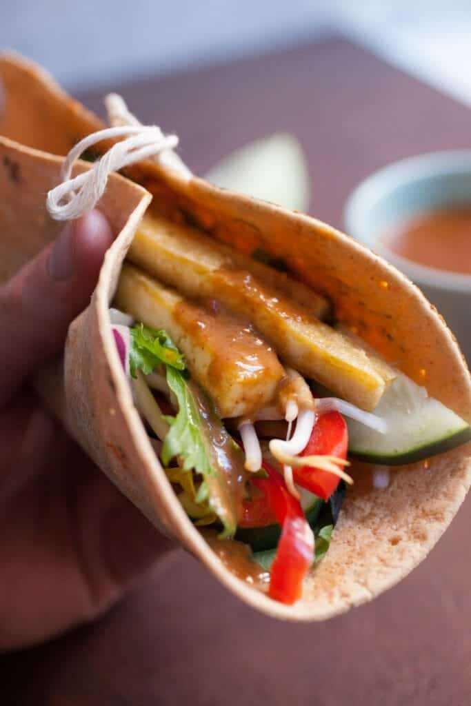Crispy Tofu Wraps with Spicy Peanut Sauce: These are one of my favorite healthy vegetarian meals. Crispy tofu that's caramelized with a little maple syrup and loaded up with crunchy veggies and an easy spicy peanut sauce! YUM! | macheesmo.com