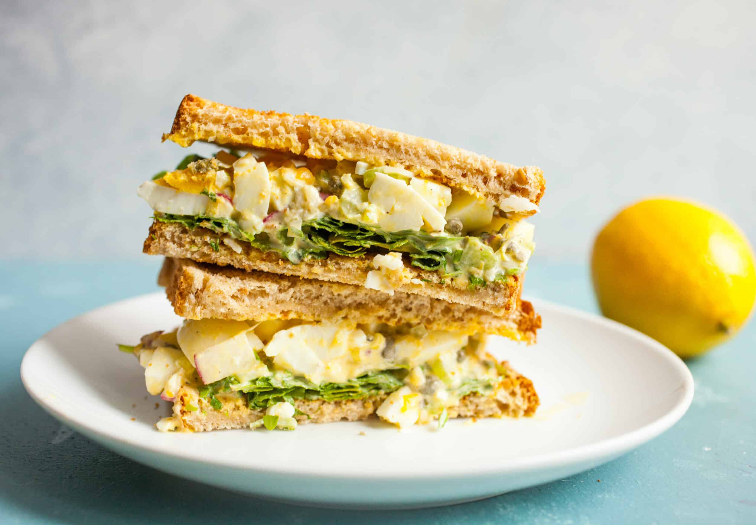 Lemon Caper Egg Salad: Egg salad can be so delicious if you make it right. This version is bright and crunchy with just enough dressing to keep it together. Serve it on white bread with some fresh arugula! | macheesmo.com