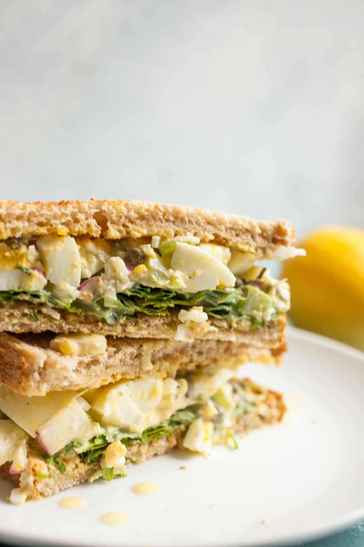 Lemon Caper Egg Salad: Egg salad can be so delicious if you make it right. This version is bright and crunchy with just enough dressing to keep it together. Serve it on white bread with some fresh arugula!   macheesmo.com