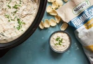 Slow Cooker Caramelized Onion Dip: This warm dip is loaded with flavor thanks to all-night-cooked caramelized onions! It uses mostly Greek yogurt to keep it relatively light and is perfect for a game day appetizer! | macheesmo.com