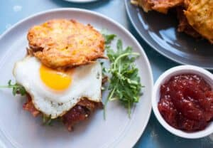 Latke Breakfast Sandwiches: Thin potato pancakes sandwiched with bacon, greens, jam, and egg. Pretty much the ultimate breakfast sandwich. Worth every minute of work! | macheesmo.com