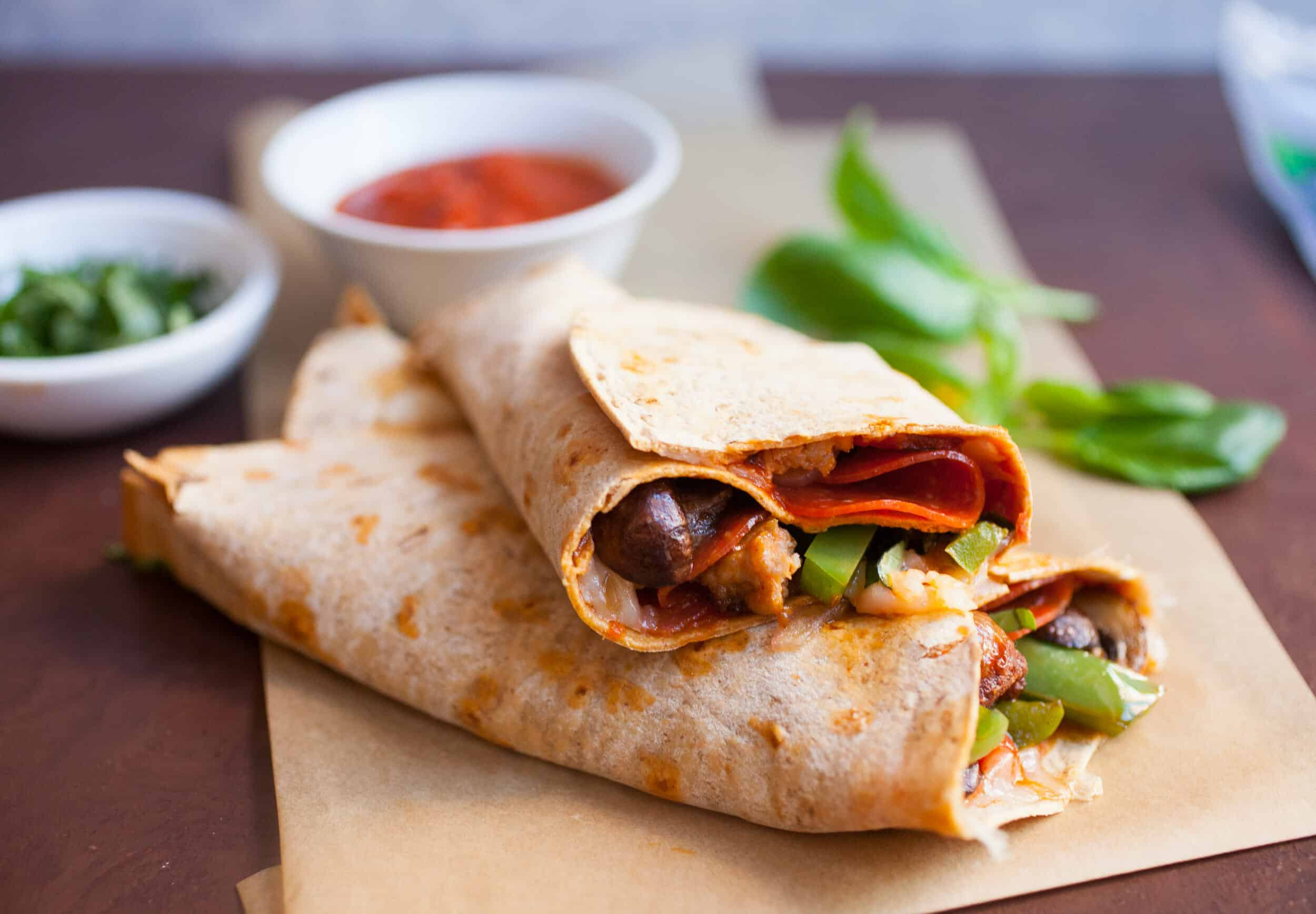 Supreme Pizza Wraps: Everything you love in a Supreme pizza except toned down a bit for wrap size. Delicious flavors and hand held! | macheesmo.com