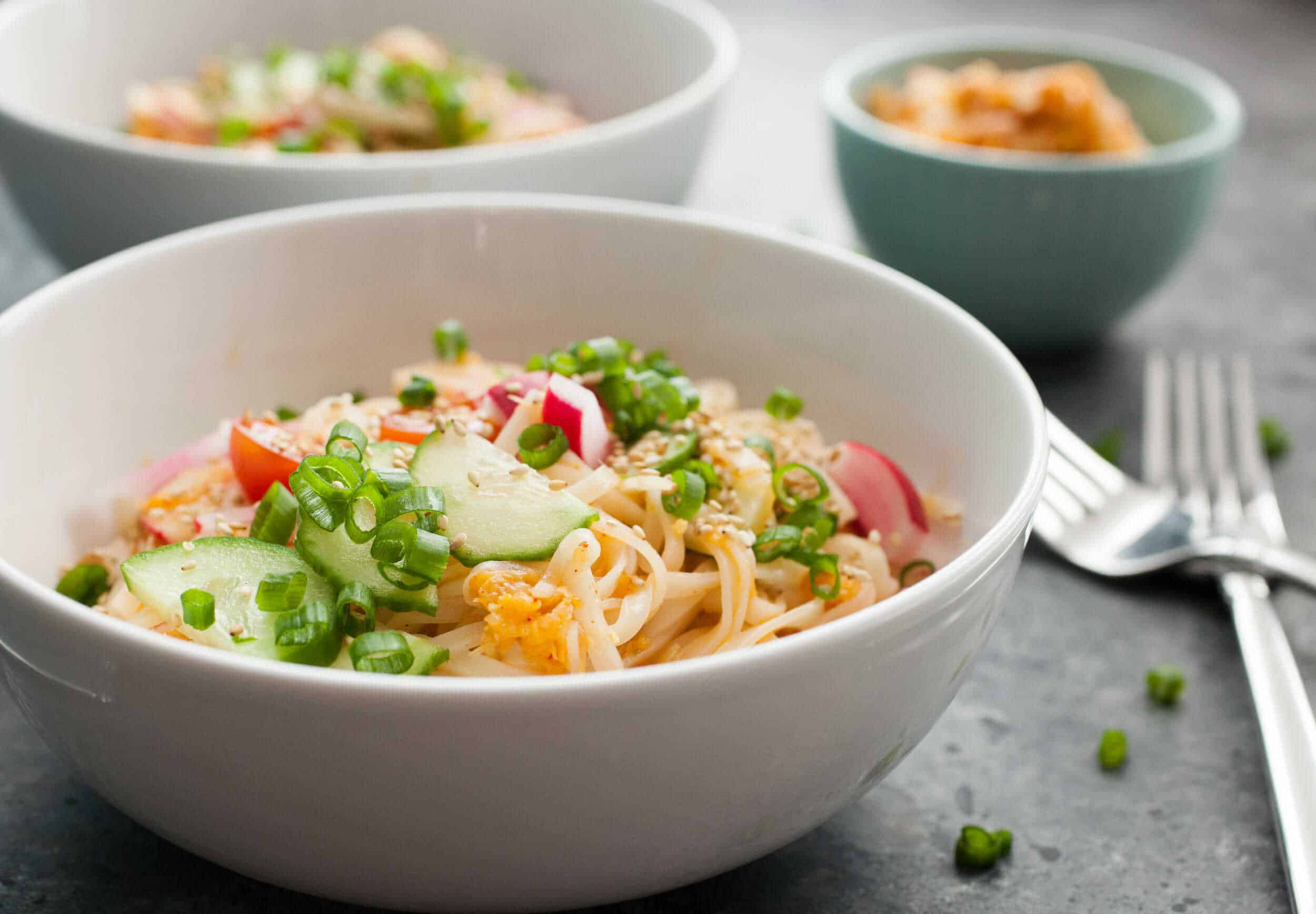 Easy Kimchi Noodles: These noodles are surprisingly flavorful for how easy they are! The key is a quick kimchi mix packed with orange zest and just enough spice! This is a great light dinner option or also good for weekday work lunches! Better on day two! | macheesmo.com