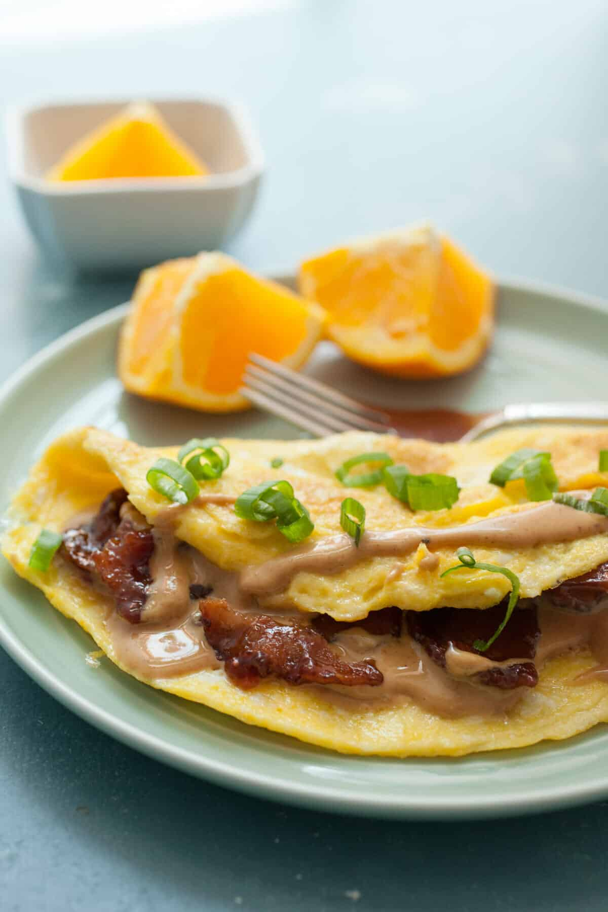 Peanut Butter Omelet with Candied Bacon: This might sound crazy, but with a few tips and tricks this omelet is ridiculously delicious. The key is some perfectly candied bacon! You gotta try this! | macheesmo.com
