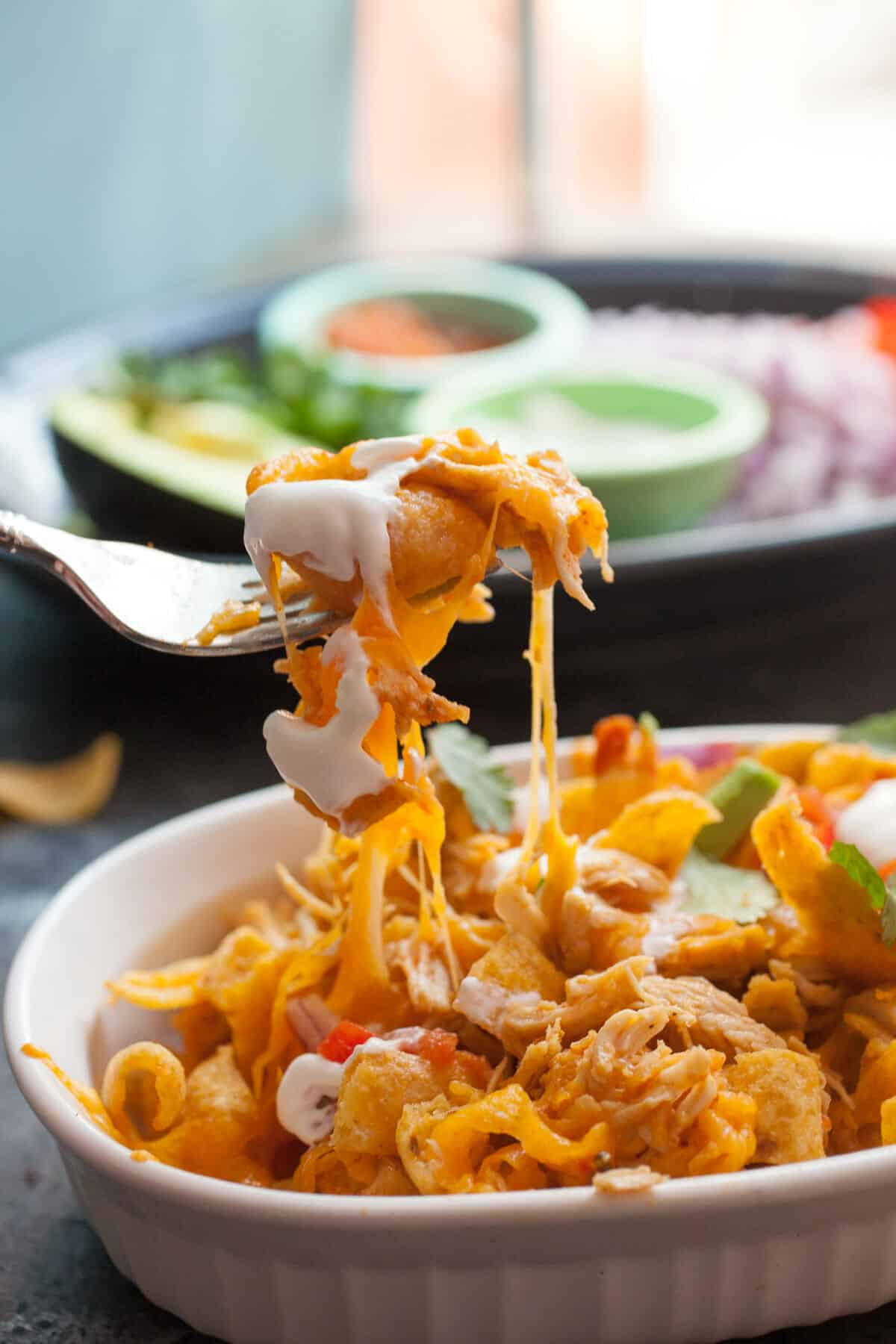 Pulled Chicken Frito Pie: These cheesy and slightly spicy Frito pies are an easy and delicious dinner. They are also an excellent game day appetizer! How can you go wrong with a good Frito Pie, right?! | macheesmo.com