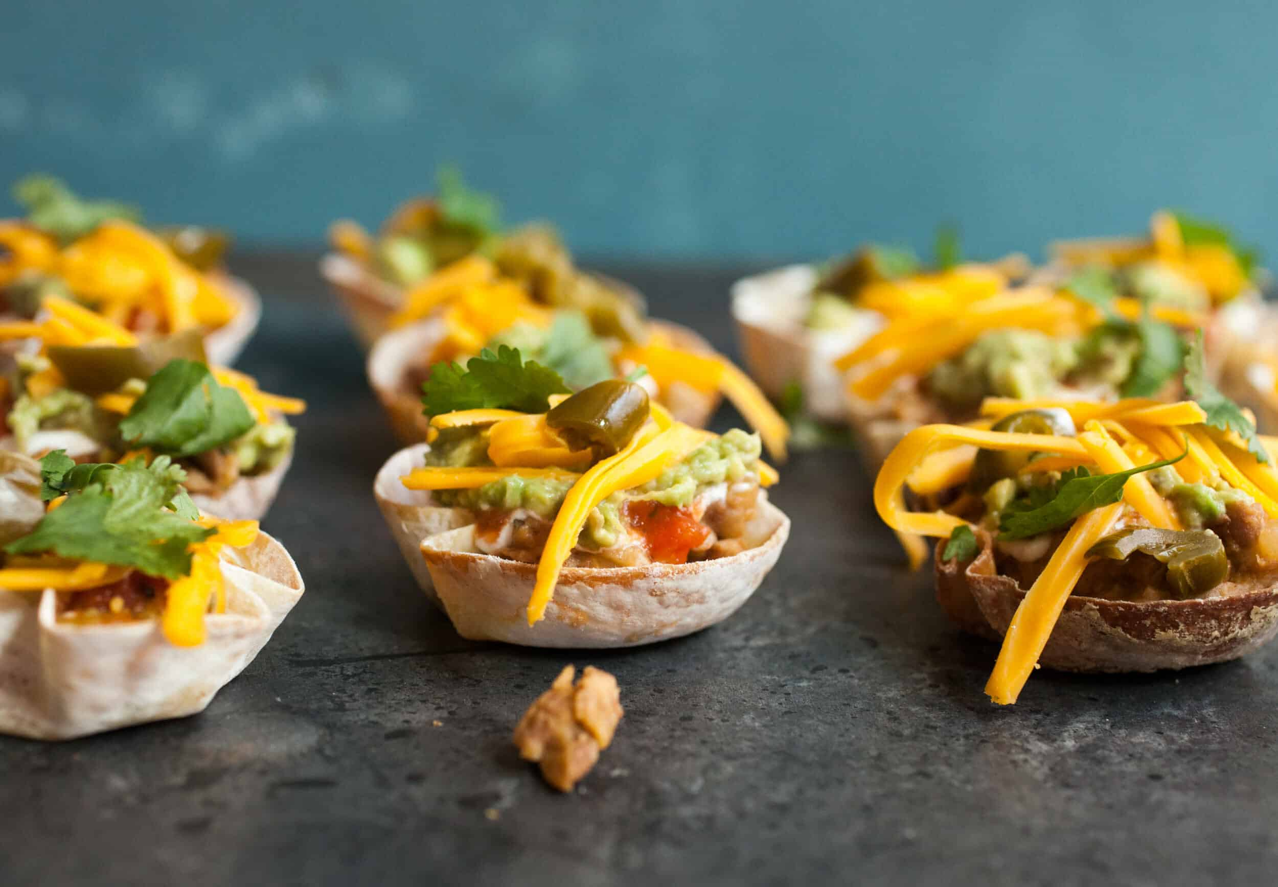 Seven Layer Wonton Cups: These are the perfect tex-mex appetizer for any party. Easy to make and really fun. Your guests will love these! | macheesmo.com