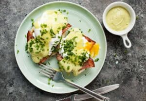 Green Eggs & Ham: This is a grown up version of green eggs and ham made in benedict form with a light avocado hollandaise sauce and fresh herbs. Thanks Sam-I-Am! | macheesmo.com