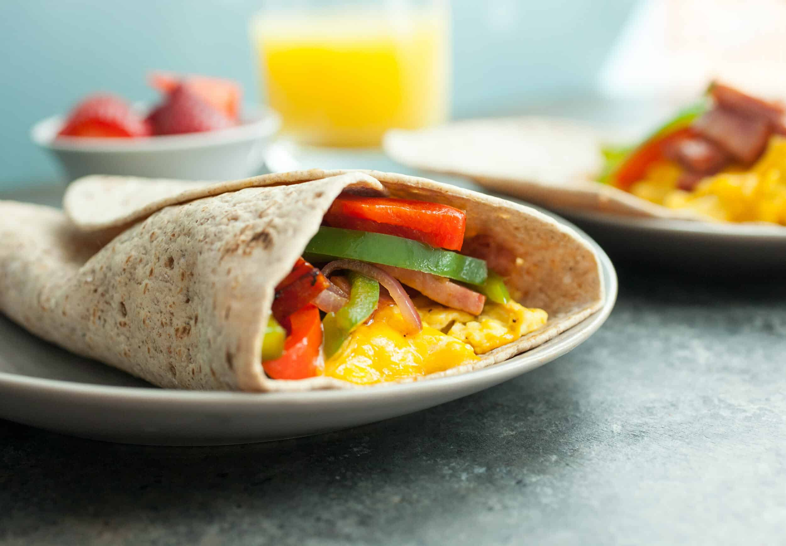 "Mile High Breakfast Wrap: Some of my favorite flavors in the classic ""Denver"" omelet but all tossed together in a Flatout Flatbread Wrap. The perfect way to kick off the day! 
