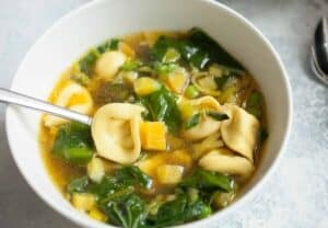 Spring Tortellini Soup: This is a really easy soup to toss together. It's filled with fresh spring veggies and tortellini. Ready in about 30 minutes! | macheesmo.com