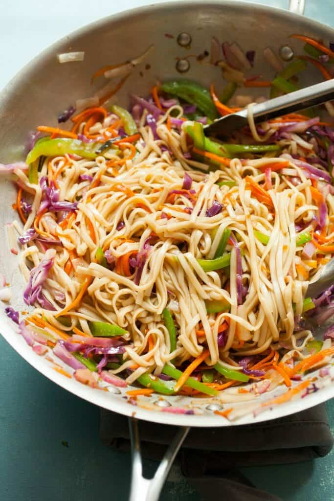 Teriyaki Rainbow Noodles: These quick noodles have a simple sweet/savory teriyaki sauce and loads of beautiful, colorful veggies. A great quick dinner and also good for a packed lunch the next day! | macheesmo.com