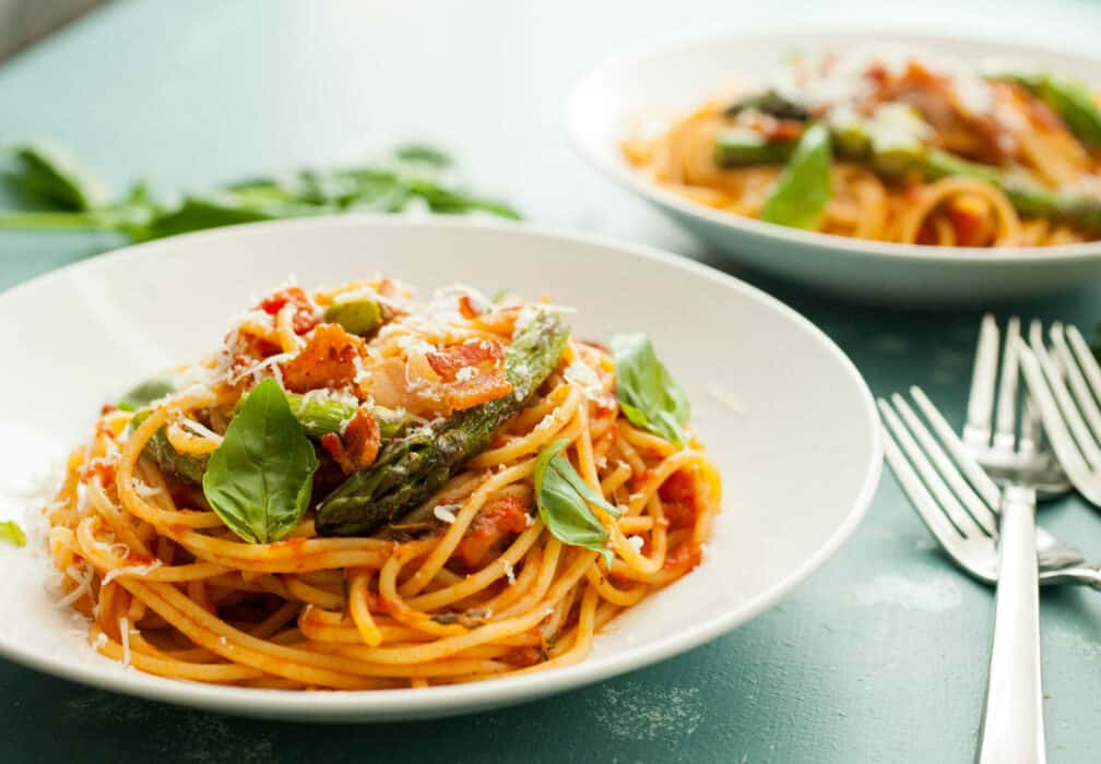 Bacon Asparagus Spaghetti: Perfect spring asparagus cooked with bacon a homemade tomato sauce and tossed with spaghetti! I love this Italian recipe! | macheesmo.com