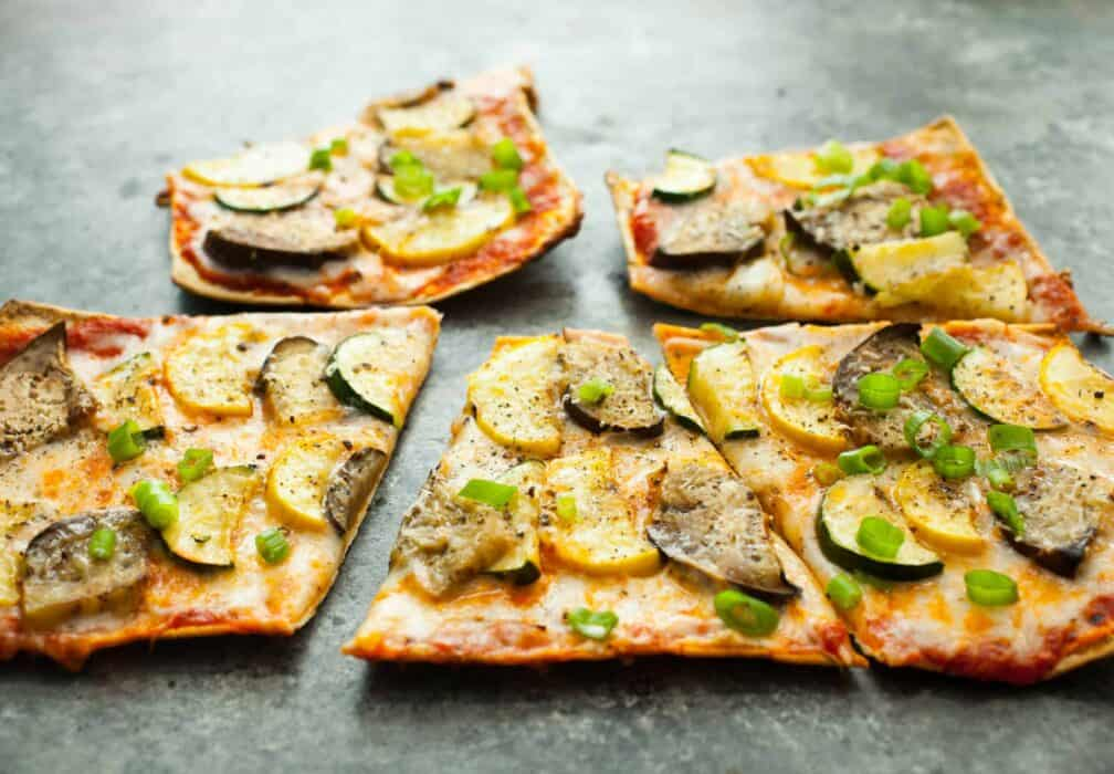 Grilled Ratatouille Pizza: This easy grilled pizza has a super-crispy crust and fresh ratatouille toppings (which are also grilled). Perfect for a summer cookout! | macheesmo.com